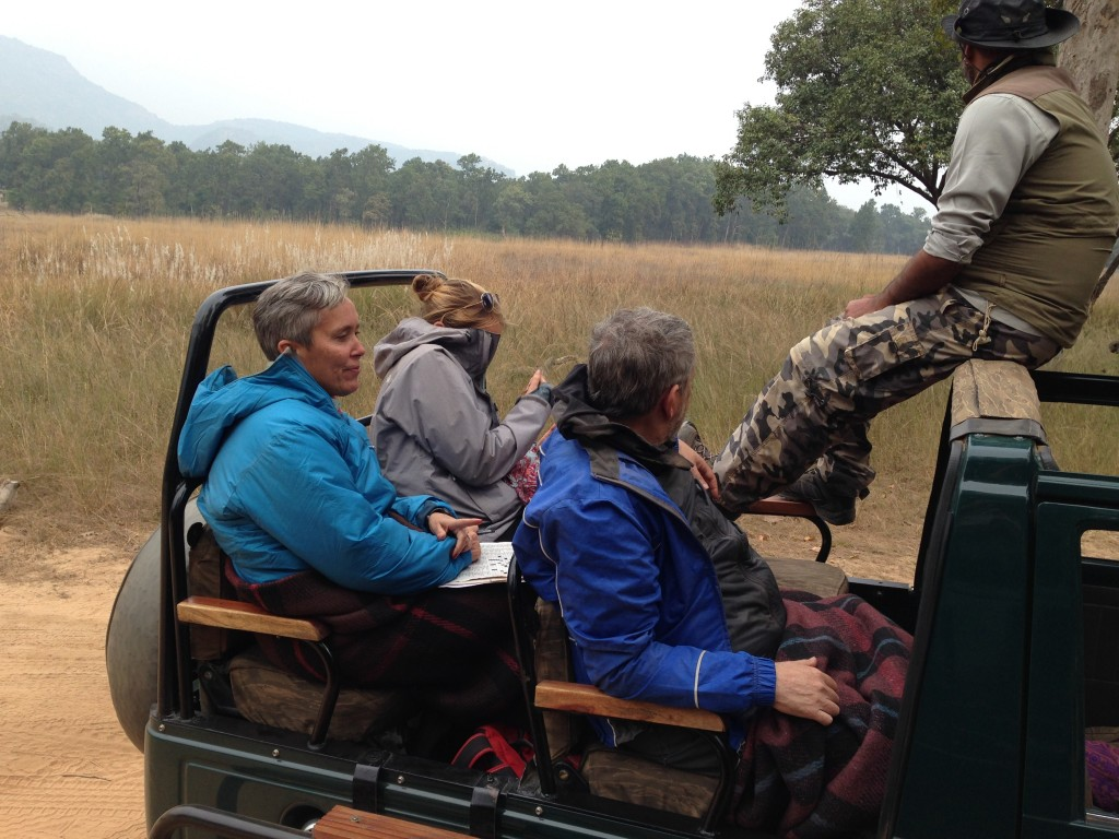How one entertains themselves while waiting for tigers - doing a crossword!!! The lady in the back seat might not be the biggest fan of the wild